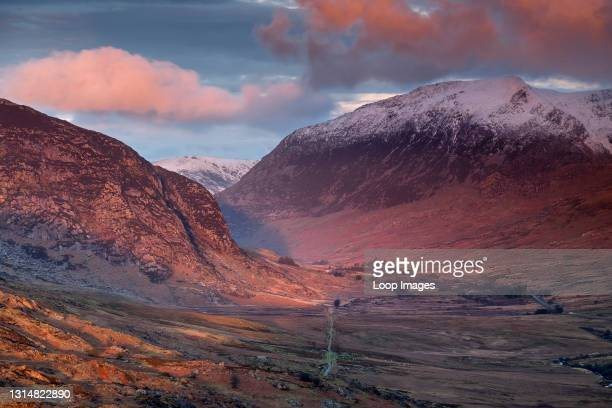 First light over the Ogwen Valley and snow capped Pen yr Ole Wen in Snowdonia.
