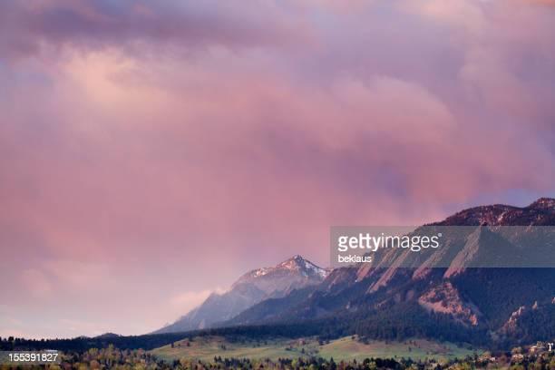 First light peeking over top of Boulder Colorado Flatirons