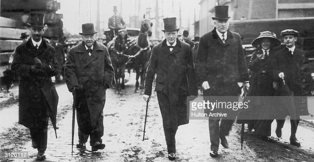 First Lord of the Admiralty Winston Churchill arrives with Admiral lord Fisher for the launch of HMS Centurion 1911