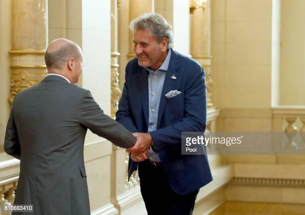 First Mayor of Hamburg Olaf Scholz welcomes Xavier Giocanti partner of International Monetary Fund managing director Christine Lagarde at the Hamburg...
