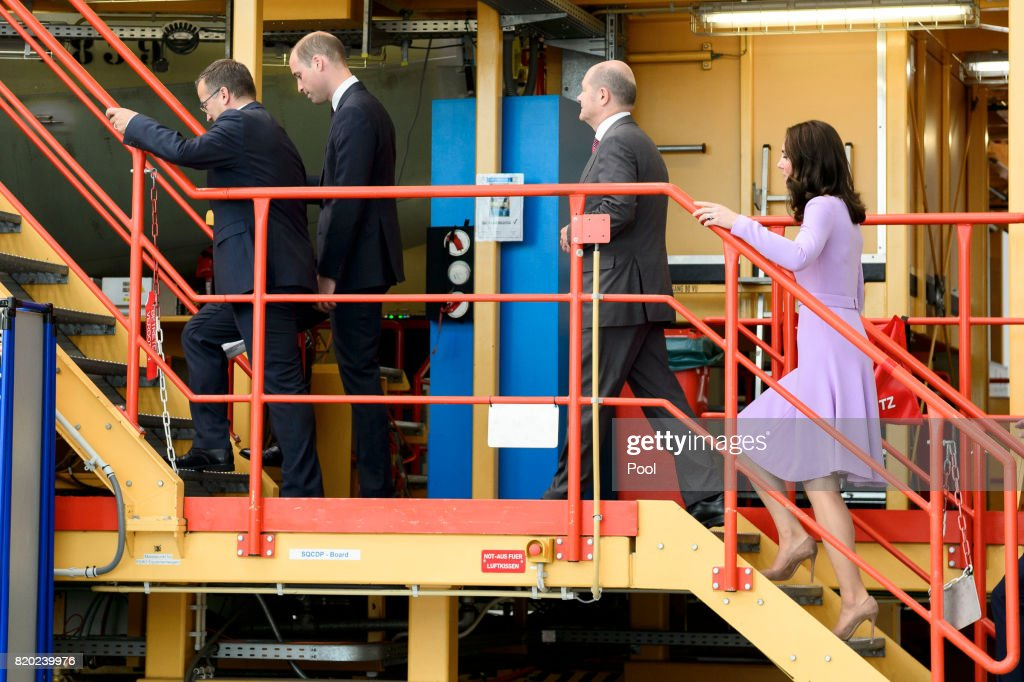 First Mayor of Hamburg Olaf Scholz (2nd-R), with Prince William, Duke of Cambridge and Catherine, Duchess of Cambridge tour Airbus before bringing their children to see helicopter models H145 and H135 ahead of departing from Hamburg airport on the last day of their official visit to Poland and Germany on July 21, 2017 in Hamburg, Germany.