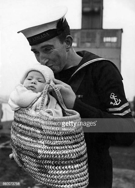 First meeting yesterday for Leading Signalman Bob Davies 29 and 'the baby in the basket' his three months old daughter Patricia Patricia and her Mum...