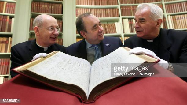 First Minister Alex Salmond , Cardinal Keith O'Brien and Bishop Richard Moth look at old church records during the launch of the Scottish Catholic...