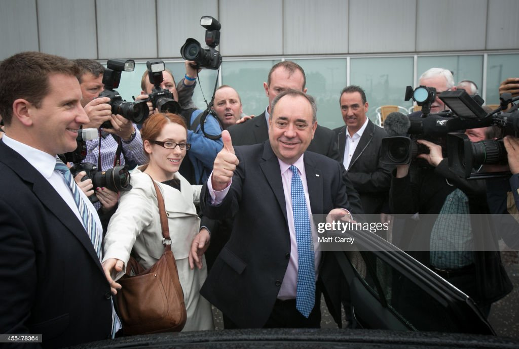 First Minister Alex Salmond gestures as he leaves Edinburgh International Airport following a photocall in the arrival's hall on September 15, 2014 in Edinburgh, Scotland. With the campaigning for the independence referendum entering into the final few days, the latest opinion polls have suggested the outcome of the vote is still too close to call.