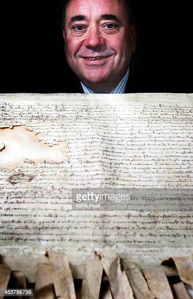 First Minister Alex Salmond is pictured with a copy of the declaration of Arbroath during a visit to Arbroath Abbey the birthplace of the Declaration...