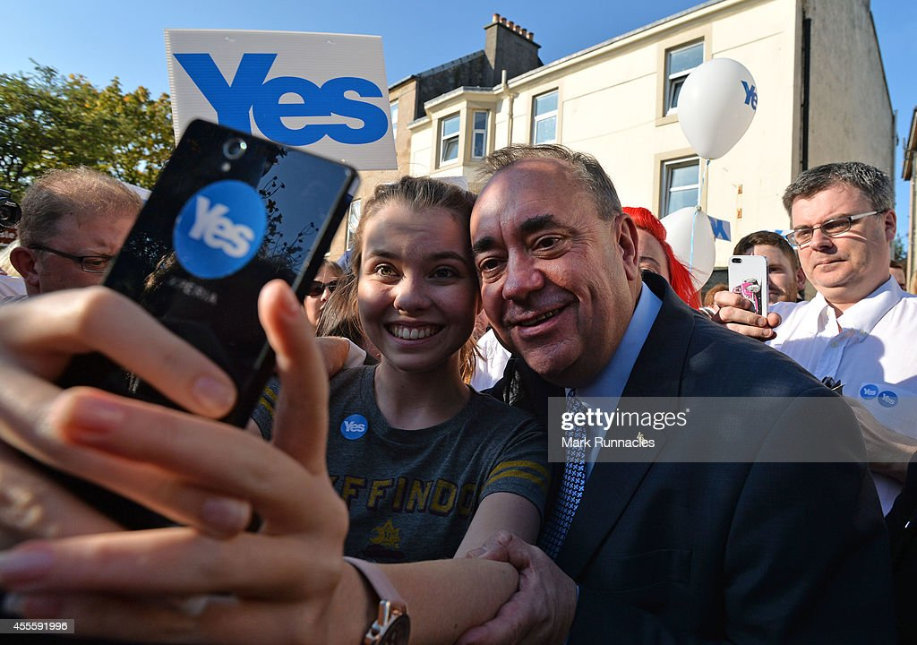 First Minister Alex Salmond (MSP), is surrounded by Yes Supporters asking for selfies during an event on the main street in the final day of campaigning for the Scottish referendum ahead of tomorrows historic vote on September 17, 2014 in Largs, Scotland. . The referendum debate has entered its final day of campaigning as the Scottish people prepare to go to the polls tomorrow to decide whether or not Scotland should have independence and break away from the United Kingdom.