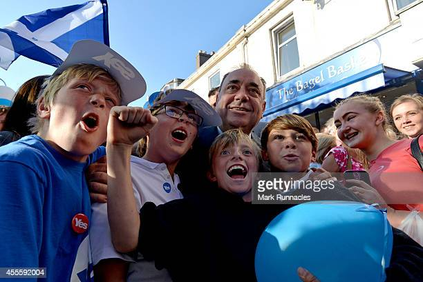 First Minister Alex Salmond is surrounded by Yes Supporters asking for selfies during an event on the main street in the final day of campaigning for...