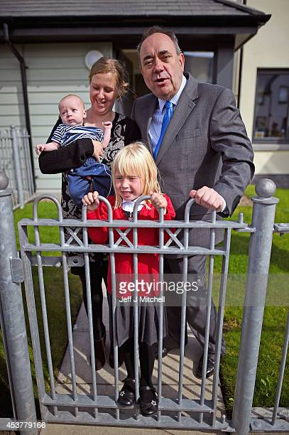 First Minister Alex Salmond meets with Sarah Forbes and her children Ethan and Ailidh during a visit to a council house building programme on August...
