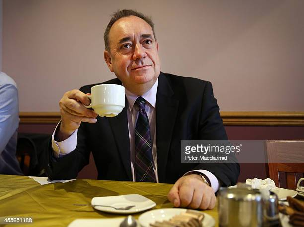 First Minister Alex Salmond relaxes with a cup of tea at a hotel during a break on referendum day on September 18 2014 in Ellon Scotland After many...