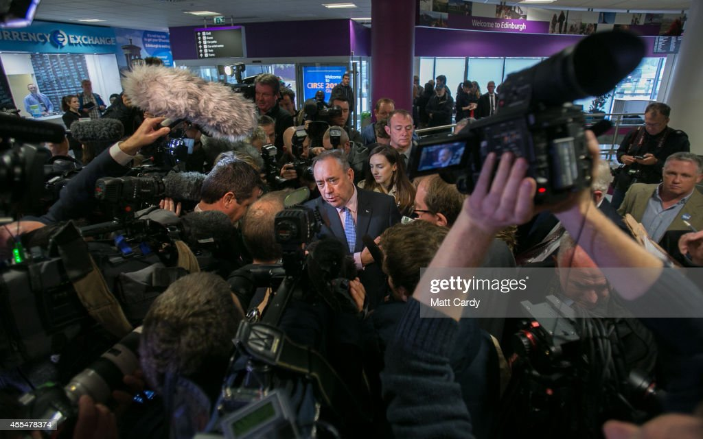 First Minister Alex Salmond speaks with the media at Edinburgh International Airport following a photocall in the arrival's hall on September 15, 2014 in Edinburgh, Scotland. With the campaigning for the independence referendum entering into the final few days, the latest opinion polls have suggested the outcome of the vote is still too close to call.