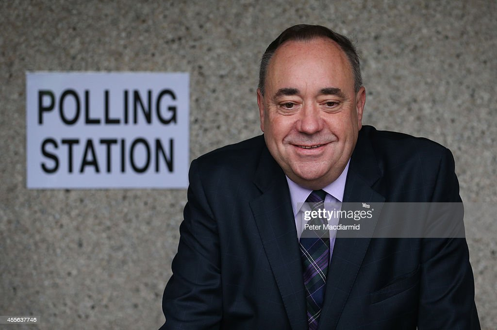 First Minister Alex Salmond stops for photographers as he casts his vote in the referendum on September 18, 2014 in Strichen, Scotland. After many months of campaigning the people of Scotland today head to the polls to decide the fate of their country. The referendum is too close to call but a Yes vote would see the break-up of the United Kingdom and Scotland would stand as an independent country for the first time since the formation of the Union.
