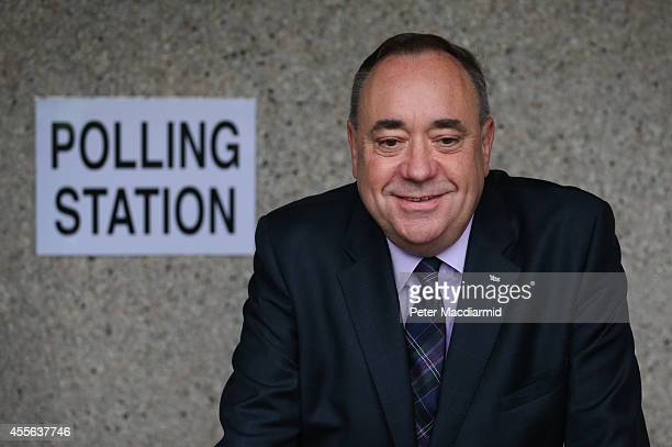 First Minister Alex Salmond stops for photographers as he casts his vote in the referendum on September 18 2014 in Strichen Scotland After many...