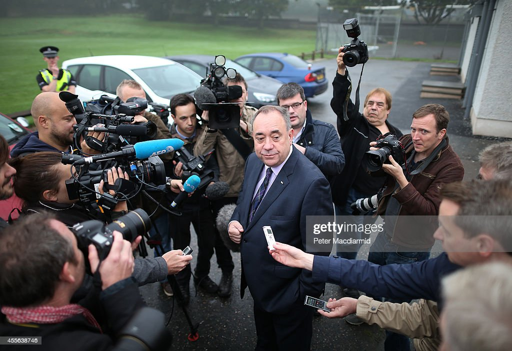 First Minister Alex Salmond talks to reporters after casting his vote in the referendum on September 18, 2014 in Strichen, Scotland. After many months of campaigning the people of Scotland today head to the polls to decide the fate of their country. The referendum is too close to call but a Yes vote would see the break-up of the United Kingdom and Scotland would stand as an independent country for the first time since the formation of the Union.