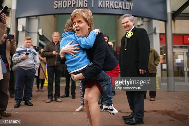 First Minister and leader of the Scottish National Party Nicola Sturgeon poses gets a hug from a small boy while campaigning for SNP candidate Roger...