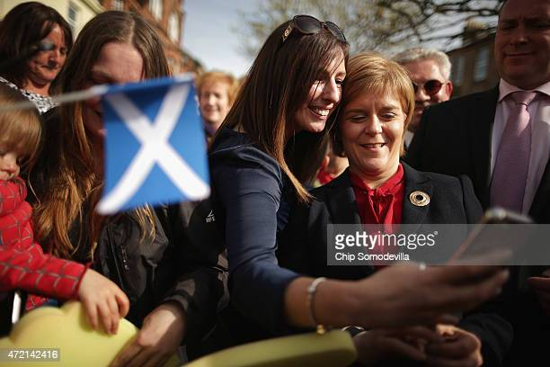 First Minister and leader of the Scottish National Party Nicola Sturgeon poses for a 'selfie' while wading through a crowd of hundreds of supporters...