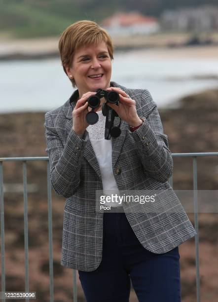 First Minister and Leader of the SNP , Nicola Sturgeon, holds a pair of binoculars as she visits the ScottishSeabird Centre on the 2021 Scottish...