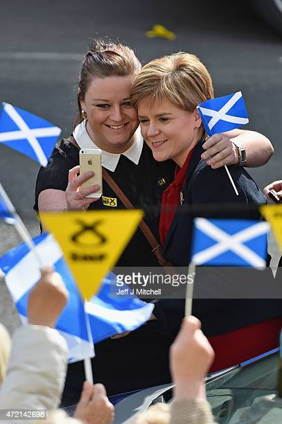 First Minister and leader of the SNP Nicola Sturgeon is welcomed by activists and members of the public during campaigning with candidate Patricia...