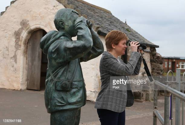 First Minister and Leader of the SNP Nicola Sturgeon looks through binoculars during a visit to North Berwick on the 2021 Scottish Parliament...