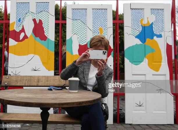 First Minister and Leader of the SNP , Nicola Sturgeon, takes a photo on her mobile phone on the 2021 Scottish Parliament election campaign trail on...