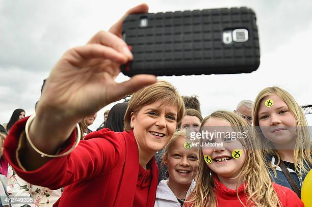 First Minister and leader of the SNP Nicola Sturgeon takes a selfie with some young supporters after being joined by the newly elected members of...
