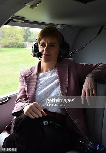 First Minister and leader of the SNP Nicola Sturgeon travels by helicopter as she campaigns on May 2 2015 in flight from Inverness Scotland...