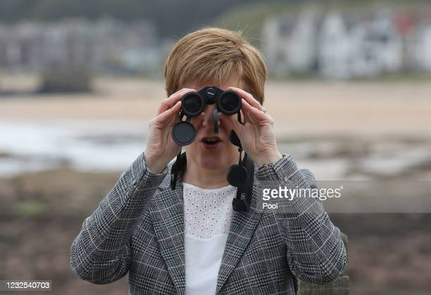 First Minister and Leader of the SNP Nicola Sturgeon uses binoculars during a visit to the Scottish Seabird Centre on the 2021 Scottish Parliament...