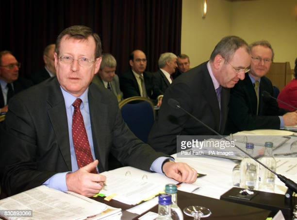 First Minister David Trimble deputy First Minister Mark Durkan and Education Minister Martin McGuinness take their seats at Armagh City Hotel for the...