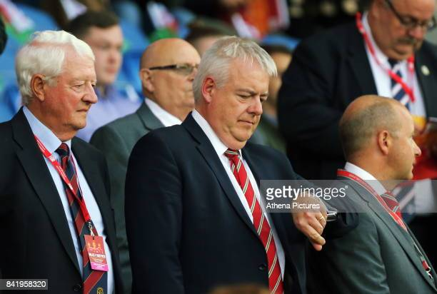 First Minister for Wales Carwyn Jones check the time during the FIFA World Cup Qualifier Group D match between Wales and Austria at The Cardiff City...