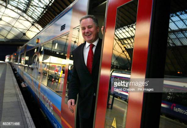 First Minister Jack McConnell holds back the automatic doors of the train as they close on him while unveiling the train operator's Commonwealth...