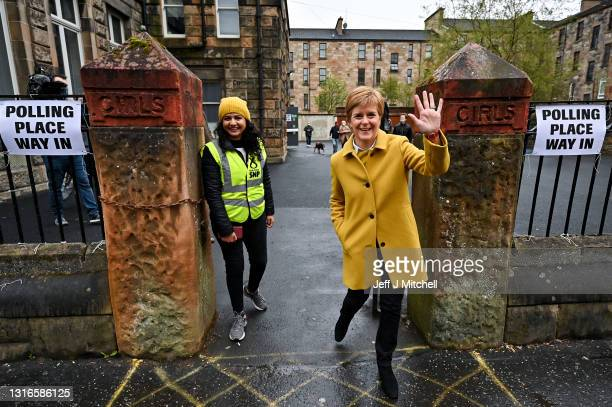 First Minister Nicola Sturgeon and candidate Roza Salih meet voters at Annette Street school polling station on May 6, 2021 in Glasgow, Scotland....
