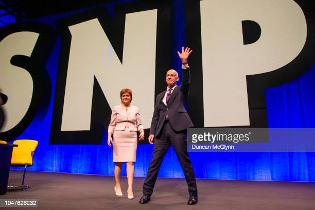 First Minister Nicola Sturgeon and Deputy First Minister of Scotland John Swinney MSP acknowledge members at the 84th annual SNP conference at the...
