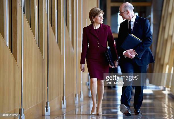 First Minister Nicola Sturgeon and Deputy Frist Minister John Swinney attend First Ministers Questions at the Scottish Parliament on April 2 2015 in...