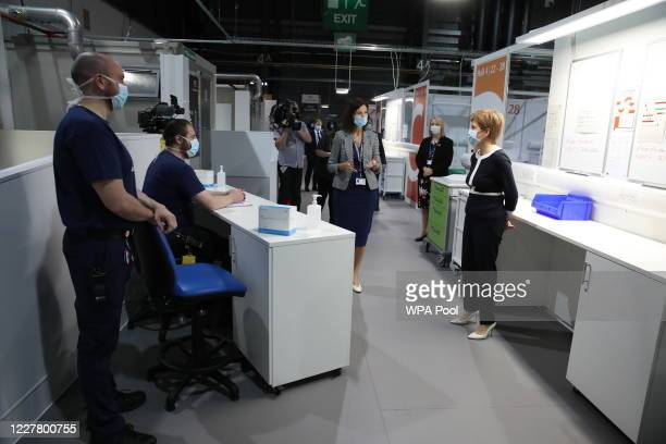 First Minister, Nicola Sturgeon and Jill Young, Chief Executive of the temporary hospital, talk to a paramedics during a visit to the NHS Louisa...