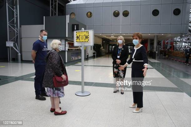 First Minister, Nicola Sturgeon and Jill Young, Chief Executive of the temporary hospital, talks to a patient during a visit to the NHS Louisa Jordan...