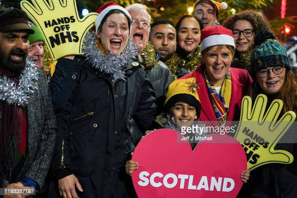 First Minister Nicola Sturgeon and SNP candidate for Glasgow Central Alison Thewliss stand beside a Christmas tree following her last general...