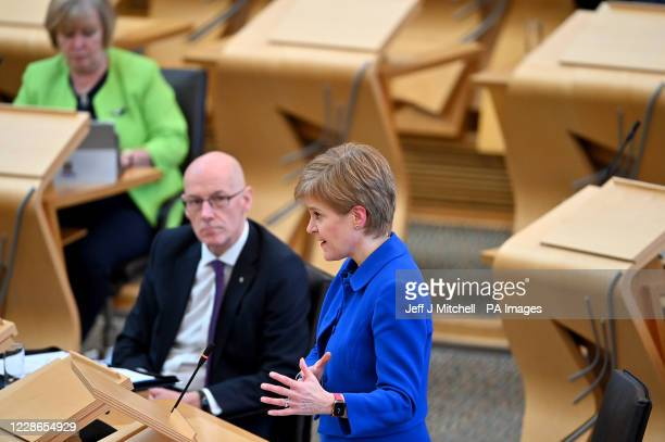 First Minister Nicola Sturgeon announces a range of new measures to combat the rise in coronavirus cases in Scotland, in the debating chamber of the...