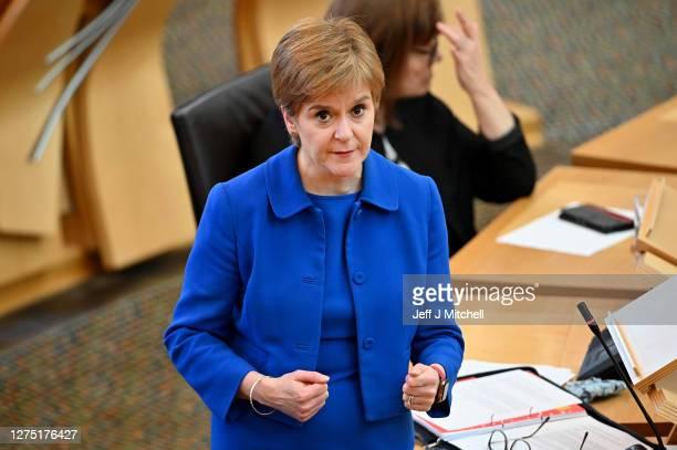 First Minister Nicola Sturgeon announces her plans to halt the spread of coronavirus at the Scottish Parliament on September 22, 2020 in Edinburgh,...
