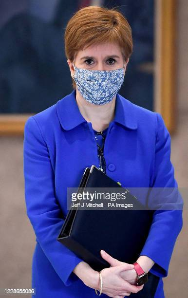 First Minister Nicola Sturgeon arrives to announce a range of new measures to combat the rise in coronavirus cases in Scotland, in the debating...