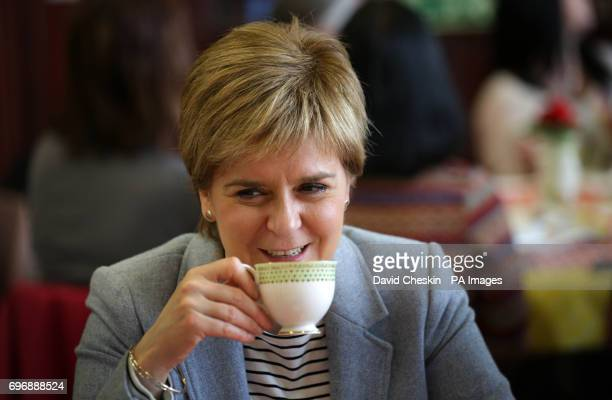 First Minister Nicola Sturgeon drinking tea at Glasgow Women's Library as she attends a tea party which is one of more than 100000 events taking...