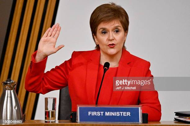 First Minister Nicola Sturgeon gestures as she gives evidence to a Scottish Parliament committee examining the handling of harassment allegations...
