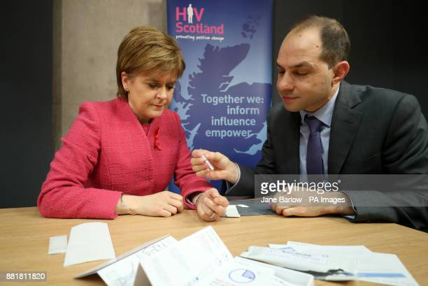 First Minister Nicola Sturgeon is given an HIV test by George Valiotis chief executive of HIV Scotland at the Scottish Parliament Edinburgh ahead of...
