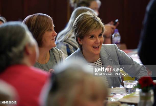 First Minister Nicola Sturgeon joins people at Glasgow Women's Library as she attends a tea party which is one of more than 100000 events taking...