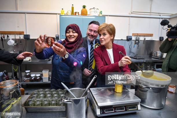 First Minister Nicola Sturgeon joins SNP election candidate Alyn Smith as they pose for a selfie at Perthshire Preserves on November 19 2019 in...