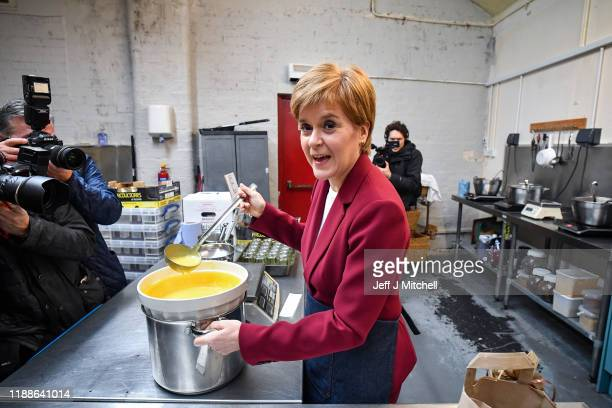First Minister Nicola Sturgeon joins SNP election candidate Alyn Smith at Perthshire Preserves on November 19 2019 in Stirling Scotland During...