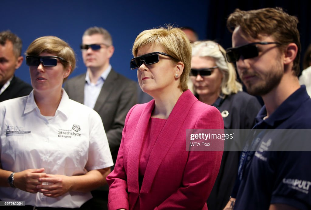 First Minister Nicola Sturgeon looks at a 3D simulator during a visit to the Advanced Forming Research Centre in Renfrew where she took a tour of the facility before making an announcement relating to the manufacturing industry in a speech to an audience of business representatives, on June 19, 2017 in Renfrew, Scotland.