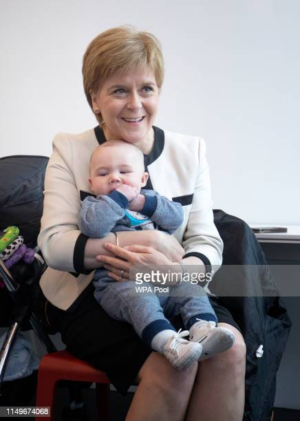 First Minister Nicola Sturgeon meets fivemonthold Axel Laurie in the HomeStart Dundee preschool group in the Thomson Learning Centre during a visit...