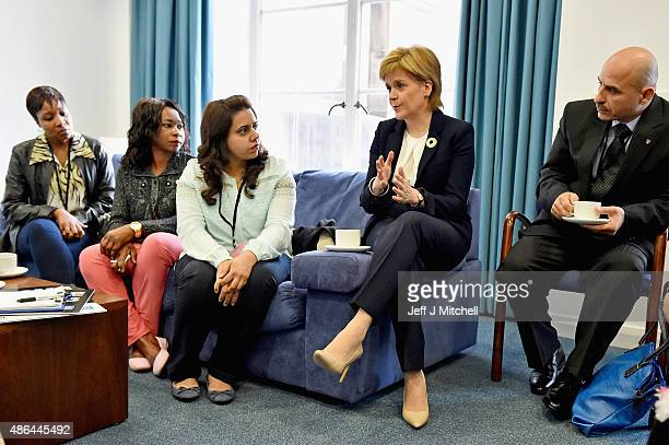First Minister Nicola Sturgeon meets with representative from refugee community during a humanitarian summit at St Andrew's House on September 4 2015...