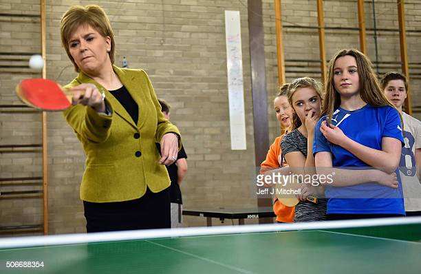 First Minister Nicola Sturgeon plays a game of table tennis as she meets pupils and staff at Queen Margaret Academy to confirm a series of new...