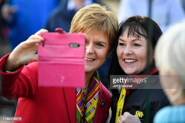 First Minister Nicola Sturgeon poses for a photo as she meets with staff and service users at Lochside Community Centre on November 4, 2019 in...