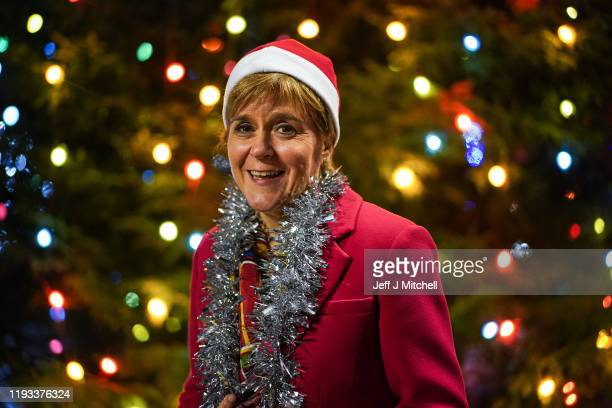 First Minister Nicola Sturgeon stands by a Christmas tree as she campaigns with SNP candidate for Glasgow Central Alison Thewliss following her last...